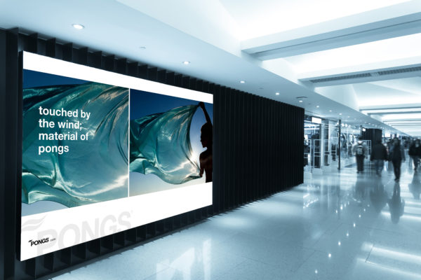 billboard in shopping mall corridor